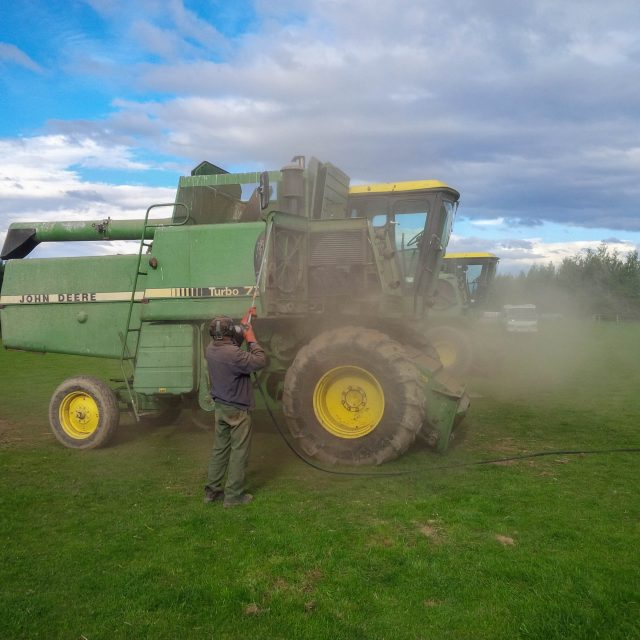 Cleaning down combine to reomove excess seed and prevent cross contamination